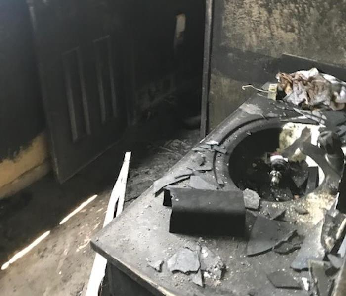 Bathroom with significant fire damage