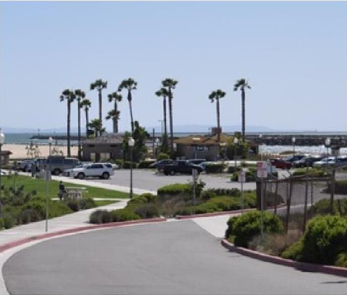 View of Seal Beach; building and street in foreground; beach in background