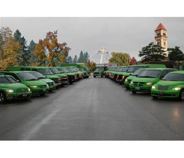 SERVPRO vans and trucks, with lights on, ready to go.