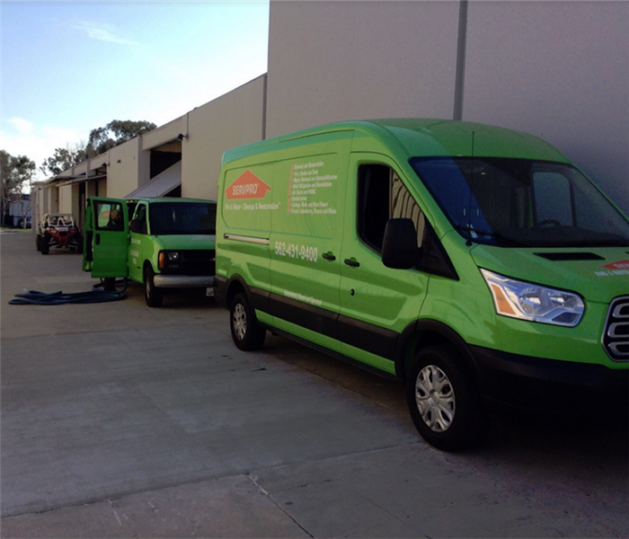 SERVPRO vehicles outside of a building