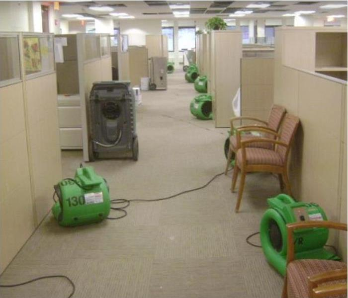 SERVPRO restoration equipment being used to dry inside of office