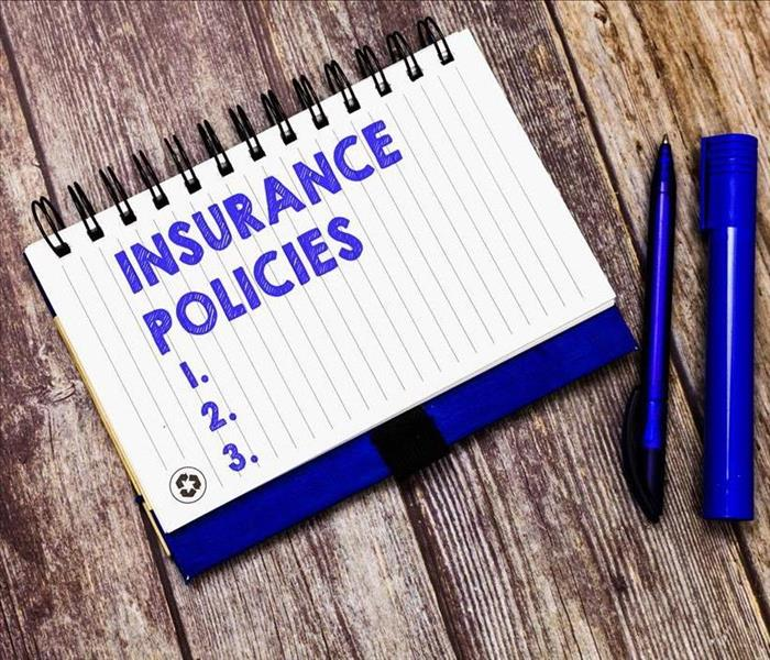 insurance policy pad on a table