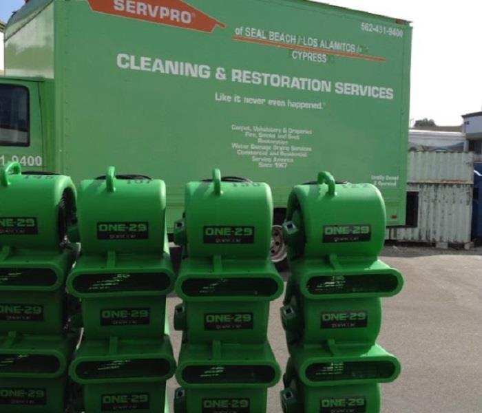 SERVPRO drying equipment stacked in front of SERVPRO truck